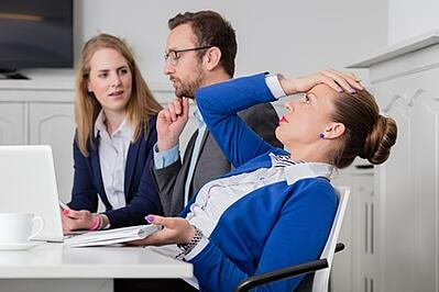 When it comes to online fundraising and charitable registration, there is no easy answer. [Image of 3 nonprofit or legal professionals in various stages of exasperation and frustration.]