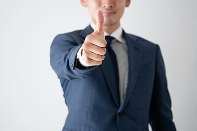 Image: Man giving a thumbs up. | Corporations in New  York need consent from the Department of Tax and Finance for various filings.