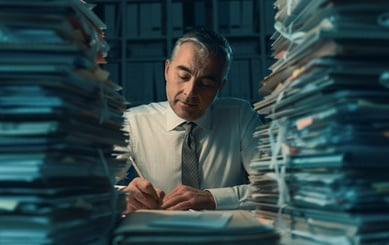 Man Filing Stacks of Paper - Fotolia_197360340_XS Cropped
