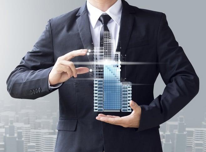 Resized for Blog - Business Man Real Estate in Hands - Springing Member - Fotolia_159196903_S