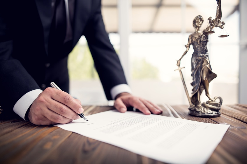 Signing bill with Justice statue scales - Fotolia_207536269_S